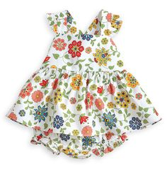 Our bloomer set stands out thanks to sweet ruffles and an adorable cross-back. The bow detail on the back of the included bloomer adds the perfect touch. 100% cotton; machine wash. Available in Lolly Floral. Sizes 3m-3y. *bella bliss® uses the finest cottons available. For best results, lay flat to dry then fluff on low heat.