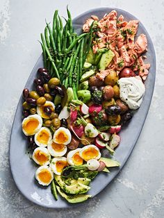 Salmon Niçoise Salad with Garlic-Herb Dressing — Saveur Herb Dressing Recipe, Salmon Nicoise Salad, Salade Nicoise Recipe, Nicoise Salad Dressing, Haloumi Salad, Salmon Salad Recipes, Clean Eating, Healthy Eating, Cooking Recipes