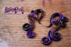 8mm Steampunk style Ear Taper / stretcher PAIR, In Purple / Black, with copper wire wrapping. £19.00, via Etsy.