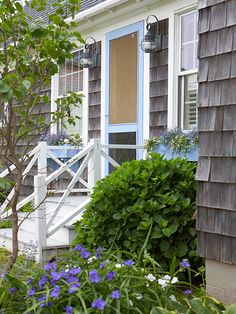 Make a cottage-charming statement by painting or staining a wooden screen door a sea or sky color that coordinates with other exterior accents: http://www.bhg.com/home-improvement/door/exterior/cottage-front-doors/?socsrc=bhgpin092314favorafind&page=10