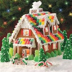 15 Gingerbread House Ideas - Bring some Christmas magic to your home with a classic holiday tradition—homemade gingerbread houses! The edible establishments made out of graham crackers or gingerbread are fun to decorate with an assortment of colorful cand Homemade Gingerbread House, Gingerbread House Parties, Gingerbread Village, Christmas Gingerbread House, Gingerbread House Decorating Ideas, Christmas Houses, Diy Gingerbread Houses, Holiday Decorating, Gingerbread Cookies