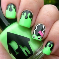Bright neon green nails with the bride of Frankenstein on them. #halloween #nails DIY NAIL ART DESIGNS