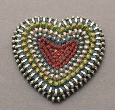 zipper hearts! I found one made into a scatter pin & I finally found the right girl to give it to for her hat. There are loads of these in many variations of the idea out there!