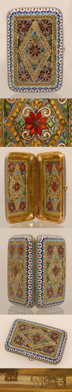 A Russian silver gilt, cloisonne and Plique-a-jour enamel cigarette case, Gustav Klingert, Moscow, circa 1891 The rectangulr case with rounded corners decorated with a multi-color geometric border around a central translucent enamel plique-a-jour diamond and triangle motif filled with scrolls and floral designs.