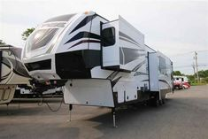 2016 New Dutchmen VOLTAGE 3970 Fifth Wheel in New York NY.Recreational Vehicle, rv, 2016 Dutchmen VOLTAGE3970, 12v Tank Heaters Interior Switches, 18 cu ft 4 Door Refer, 2nd 15.0 BTU A/C, 2nd Awning Over Garage Entrance Door, 3 Season Patio Doors, 3rd A/C in Garage, 6pt. Hydraulic Auto Leveling, Decor- Raven, Exterior- White, Garmin Wireless Navigation, Happi-Jac Electric Bed, Onan 5.5 Generator, Outside Entertainment Center, Pin Box, Power Vent Fan-Garage, Ramp Patio, Removable Edged Cargo…