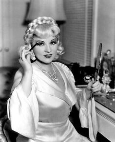 Mae West putting on Makeup