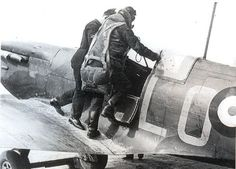 F/L Marcus Robinson of No 602 Squadron RAF climbs into the cockpit of Spitfire Mk Ia LO-H at RAF Drem in April 1940. The aircraft was damaged by P/O Henry W Moody at the Scottish airfield on 23 July when it overshot and crashed into a hedge after several attempts to land in thick coastal fog. Robinson rose to acting squadron leader on 1 June 1940 becoming CO of No 616 Squadron RAF.