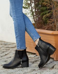 I like the heel height, color and style of this shoe.  Like that there is some texture not just straight black.
