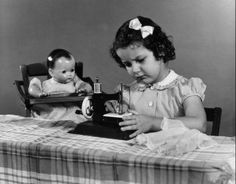 Girl sewing for her doll (1945)