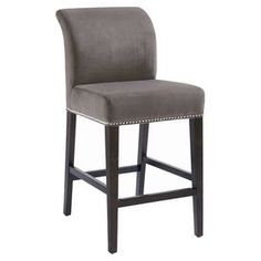 """Perfect for sipping fresh cocktails with friends or enjoying Sunday brunch, this wood-framed counter stool showcases an upholstered seat and nailhead trim.  Product: Counter stoolConstruction Material: Wood and fabricColor: GreyFeatures: 26"""" Seat heightDimensions: 42"""" H x 18"""" W x 24.5"""" D"""