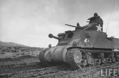 American M3 Grant tank churning through thick mud during the North African campaign. Location: Tunisia Date taken: February 1943 Photographer: Eliot Elisofon