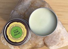 Organic Paw Balm for Dogs! Keep your best friend's paws free from the dryness and cracking that comes with cold weather, rough terrain, ice, snow, and chemical snow melt placed on roads and sidewalks.  When paw pads take more of a beating than nature intended, they form a thick layer of protective callus, which is much less flexible than the pad itself. When the callus gets too much activity it's prone to crack and cause discomfort.