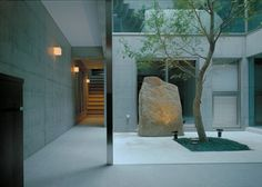 Inside the Japanese house featuring a wall that appears to have been folded down like a piece of paper.