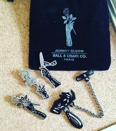 Don't sleep on this @johnnygloom collection from @ballandchainsociety. They're so pretty in person. That chain is amazing quality. Now I have to rearrange my jacket #johnnygloom #ballandchainco #pins #pingame #pingamestrong #goth #gothic #bdsm #slave #master #masterandservant #spooky #domme by l3ahkn1ts