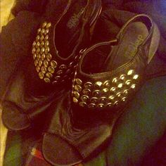 Black studded wedges Black studded wedges. Shoes have slight creasing on top of foot. Cute shoe great for a casual night or even a concert! Charlotte Russe Shoes