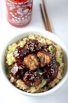 HEALTHY 30 MINUTE SRIRACHA TERIYAKI MEATBALL BOWLS -- Look at how much goodness is going on in this bowl. Get the recipe from Baker By Nature.