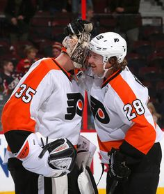Steve Mason #35 and Claude Giroux #28 Philadelphia Flyers