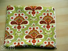 """Making a """"wet"""" bag using cheap shower curtain/vinyl....sew together fabric, vinyl & zipper. Great tut on sewing zippers too! I'd make mine a makeup bag....perfect so you can wipe it out to keep clean!"""