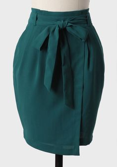 French Riviera Skirt In Emerald 42.99 at shopruche.com. Perfected with a removable self-tie belt, this sophisticated emerald  skirt features a faux wrap design and gathered detailing at the waist.  Finished with side pockets and a hidden back zipper closure, this  gorgeous skirt is a definitely wardrobe...