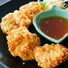 A crunchy coconut shrimp recipe that is delicious served with a spicy dipping sauce.