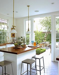 Love this kitchen's finishes, and the fact that it opens out to the yard