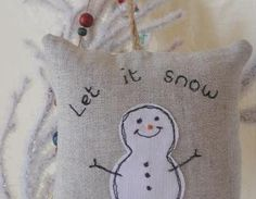 """Let it snow"" linen mini hanging pillow. Free machine stitched snowman applique and text to the front with a hand stitched orange carrot nose. Plain linen on the back. Hangs with rustic twin.."