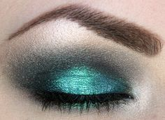 Matte black on the lid (MAD Minerals - Black), black with a blue/green sheen (Earth Goddess Minerals - Midnight Black) and champagne colored highlighter (MAC - Shroom). Some black kohl on the waterline and then mascara. Then give it a kick with some turquoise (MAD Minerals - Whisper Mint).