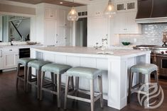 Curved Island Countertop, Transitional, Kitchen.  I like the craftsman type pillars in the island.  I love the stools too!