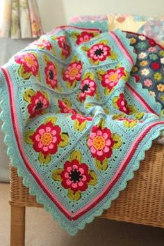 Painted Roses Blanket    Inspired by the 'roses and castles' decorations found on canal  narrowboats,  this pretty rose square motif makes ...