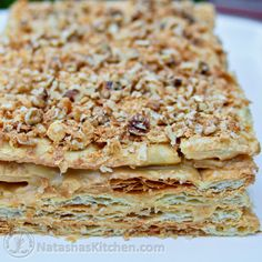 This Russian Napoleon Cake is the sweetest taste from my childhood. Buttery, flaky pastry layers generously filled with sweet cream filling - a must try!