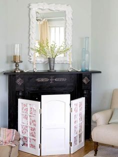 Fireplace screen made out of  window sashes and/or cabinet doors