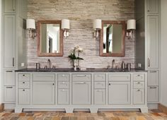 Stone back splash with wood framed mirrors. Beautiful!