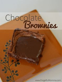 Homemade, from scratch chocolate brownies are my favorite dessert. Perfect, smooth chocolate texture with easy to make chocolate fudge icing.