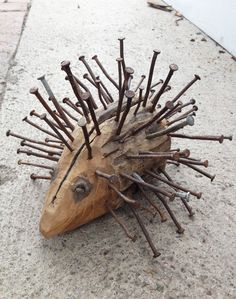 DIY Hedgehog made of piece of wood and rusty nails.