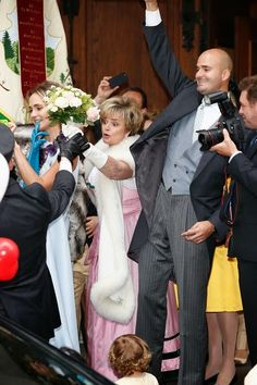 """(L-R) Princess Elisabeth von Thurn und Taxis, Gloria von Thurn und Taxis & Prince Albert von Thurn und Taxis seen after the WEDDING ceremony of Princess Maria Theresia von Thurn und Taxis & Hugo Wilson on 13 Sept 2014 in Tutzing, Germany   """"Royal Family Around the World"""""""