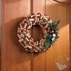 Holiday Wine Cork Wreath. This may  help to dispose of SOME of the evidence. @Jill Slack