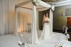 Beautiful chuppah - Love the chupah, but the background and flooring take away from its simple elegance.