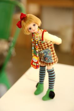 Such a cute doll....love the face and hair and the outfit is adorable!