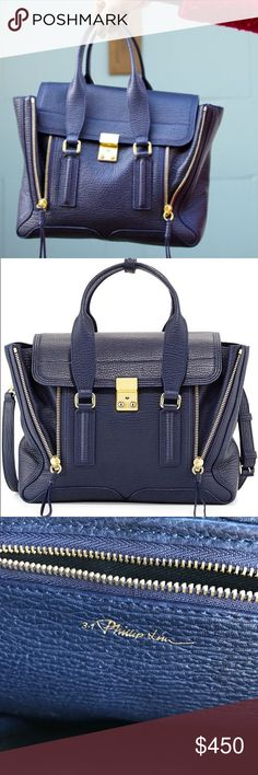 """Gorgeous Phillip Lim Pashli medium purse Gently used. No signs of wear except very minor indications on inside of purse please note ******DOES NOT INCLUDE DUSTBAG OR LONG STRAP. The Pashli is a gorgeous navy colors has zipper gussets that un-zip into a fan shape & push-lock closure on the top flap.  - 100% Full Grain Leather  - 10""""H x 12.5""""W x 4""""D  - 4' Top Handle drop. Price is Firm unless bundled 3.1 Phillip Lim Bags Satchels"""