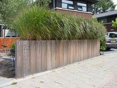Adres op houten schutting Adres fence. Steiger hout