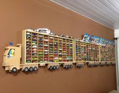"If you are a hot wheels collector then you will appreciate these display efforts here. Hot wheels have become a ""toy"" that is not only played with and collected by children. Hot Wheels Display, Hot Wheels Storage, Hanging Storage Shelves, Ceiling Storage, Large Toy Storage, Toy Car Storage, Truck Storage, Wooden Truck, Kids Bedroom Ideas"