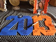 Graduation party idea - all one color though. Like for me, I'm thinking a BRIGHT red (a dark red will be hard to see) with a black marker (school colors). Also make it hang-able so the graduate can put it in room