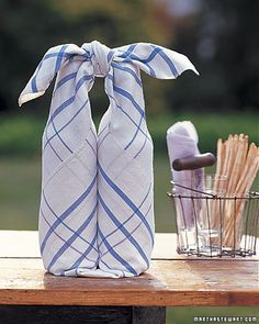 This quick folding trick helps you get a handle on picnic wines, then yields a place to lay your outdoor feast.