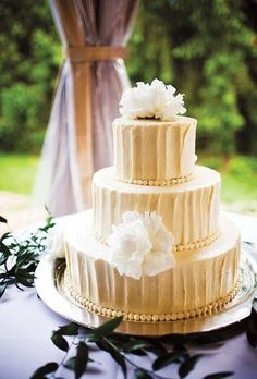 Vanilla pound wedding cake with cream cheese frosting (served with a fresh berry sauce). Photo by Scott Lewis.