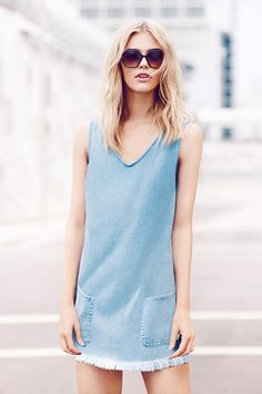 So versatile, you can wear this denim tunic dress on its own when it's hot or layered over a top when it's cool. #newlook #fashion