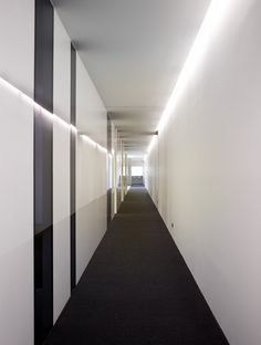 Black and white Corridor, Acer office in Barcelona by architect Francesc Rife _