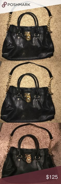 Great condition Small authentic Michael kors purse Small, black and gold, authentic Hamilton Michael kors purse, in great condition. Measures 12 inches long by 9 inches tall KORS Michael Kors Bags Crossbody Bags
