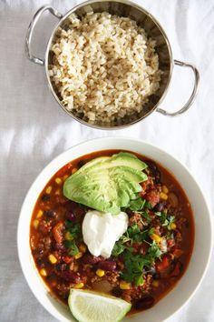 Chilli con carne with brown rice, avocado and sour cream
