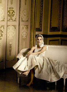 Recently photographed by Peter Lindbergh in January 2011, Natalie Portman sits casually in a Rochas white silk dress.