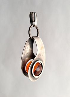 Perfect for the creative captive challenge. Can this be my entry?! 1950's Paul Lobel American Modernist Amber Pendant